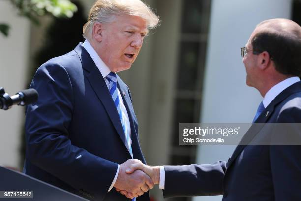 S President Donald Trump shakes hands with Health and Human Services Secretary Alex Azar following an announcement about drug prices in the Rose...