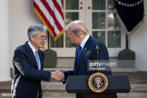 S President Donald Trump shakes hands with his nominee for the chairman of the Federal Reserve Jerome Powell during a press event in the Rose Garden...