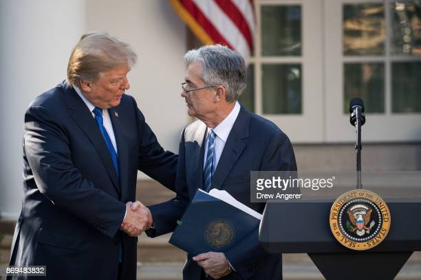 US President Donald Trump shakes hands with his nominee for the chairman of the Federal Reserve Jerome Powell during a press event in the Rose Garden...