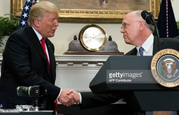US President Donald Trump shakes hands with Ian Read CEO of Pfizer during the announcement of a a newly designed Made in America pharmaceutical glass...
