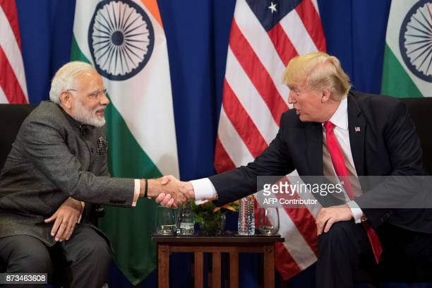 US President Donald Trump shakes hands with Indian Prime Minister Narendra Modi during a bilateral meeting on the sideline of the 31st Association of...