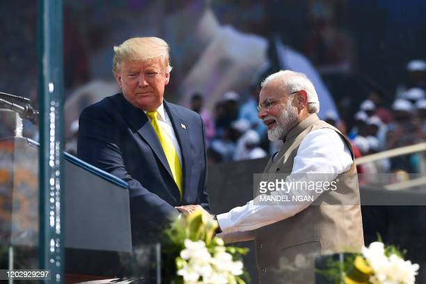 President Donald Trump shakes hands with India's Prime Minister Narendra Modi during 'Namaste Trump Rally' at Sardar Patel Stadium in Motera, on the...