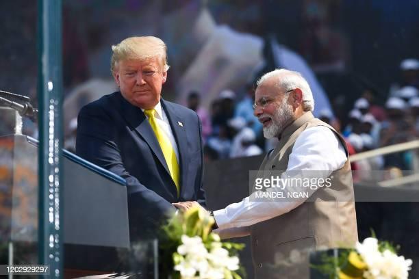 US President Donald Trump shakes hands with India's Prime Minister Narendra Modi during 'Namaste Trump Rally' at Sardar Patel Stadium in Motera on...