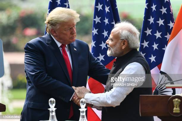 US President Donald Trump shakes hands with India's Prime Minister Narendra Modi during a joint press conference at Hyderabad House in New Delhi on...
