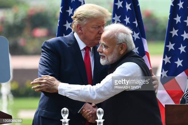 President Donald Trump shakes hands with India's Prime Minister Narendra Modi during a joint press conference at Hyderabad House in New Delhi on...