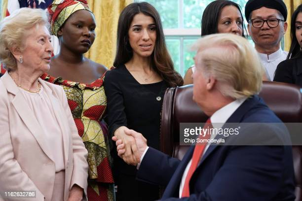 S President Donald Trump shakes hands with Iraqi Yazidi human rights activist and Nobel Peace Prize winner Nadia Murad of Iraq while he hosts her and...