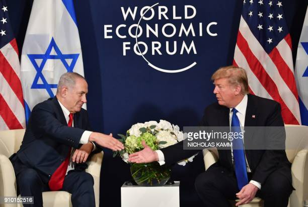 US President Donald Trump shakes hands with Israel's Prime Minister Benjamin Netanyahu during a bilateral meeting on the sidelines of the World...