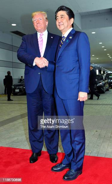 S President Donald Trump shakes hands with Japanese Prime Minister Shinzo Abe prior to their bilateral meeting as he arrives on the first day of the...