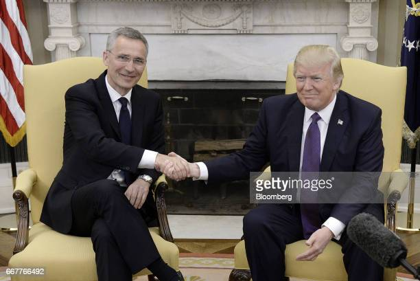 US President Donald Trump shakes hands with Jens Stoltenberg secretary general of the North Atlantic Treaty Organization right following a meeting in...