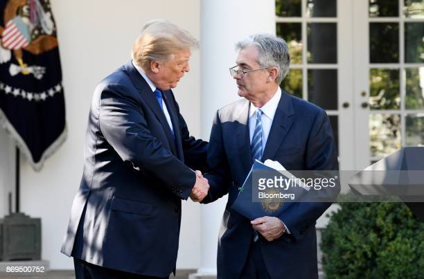 US President Donald Trump shakes hands with Jerome Powell governor of the US Federal Reserve and Trump's nominee as chairman of the Federal Reserve...