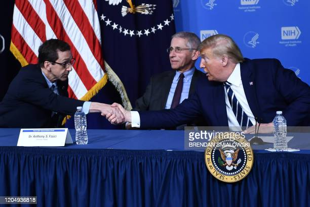 US President Donald Trump shakes hands with John Mascola Director of the Vaccine Research Center at the National Institute of Allergy and Infectious...
