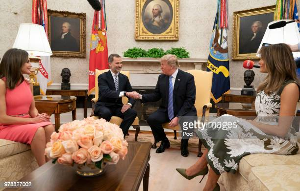 US President Donald Trump shakes hands with King Felipe VI of Spain as first lady Melania Trump and Queen Letizia of Spain look on at The White House...