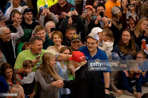 US President Donald Trump shakes hands with locals at the Jefferson Avenue Church of Christ disaster relief distribution center after touring tornado...
