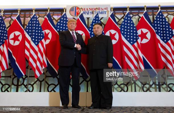 President Donald Trump shakes hands with North Korea's leader Kim Jong Un before a meeting at the Sofitel Legend Metropole hotel in Hanoi on February...