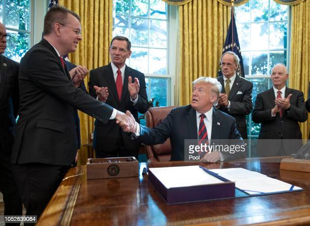 US President Donald Trump shakes hands with Pastor Andrew Brunson prior to signing S3021 America's Water Infrastructure Act of 2018 in the Oval...