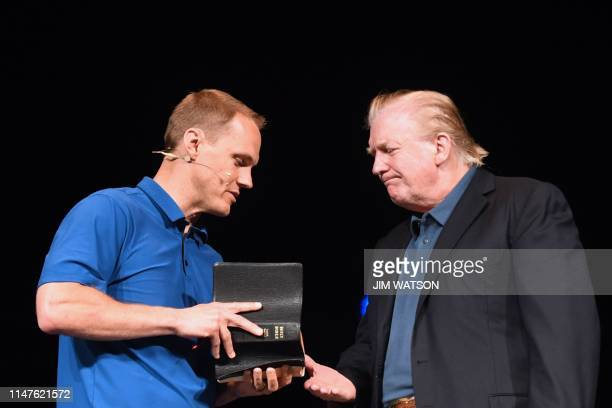 US President Donald Trump shakes hands with Pastor David Platt as he visits McLean Bible Church in Vienna Virginia on June 2 to pray for the victims...