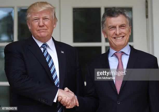 President Donald Trump shakes hands with President Mauricio Macri of Argentina shortly before meeting in the Oval Office of the White House on April...
