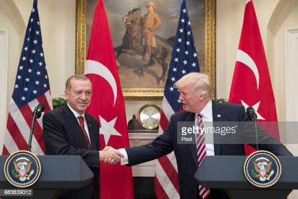 President Donald Trump shakes hands with President of Turkey Recep Tayyip Erdogan in the Roosevelt Room where they issued a joint statement following...