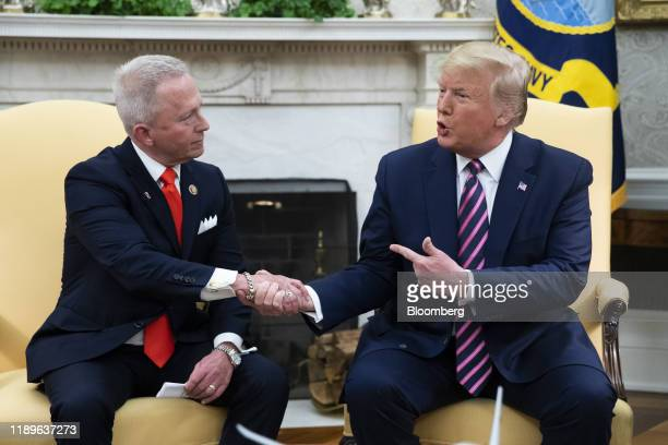 US President Donald Trump shakes hands with Representative Jeff Van Drew a Democrat from New Jersey left in the Oval Office of the White House in...