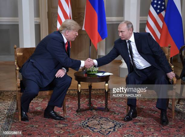 US President Donald Trump shakes hands with Russia's President Vladimir Putin during a meeting in Helsinki on July 16 2018