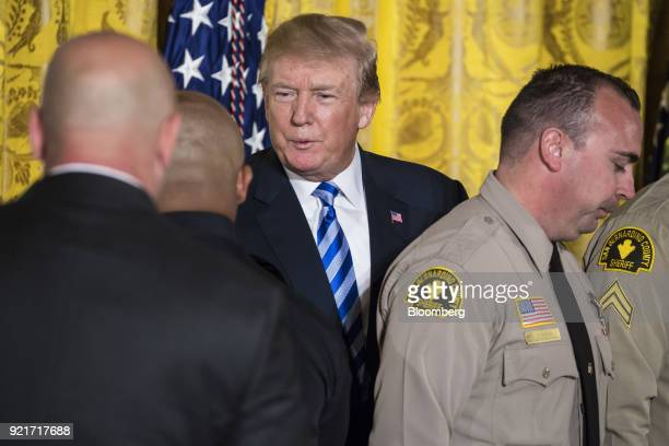 US President Donald Trump shakes hands with San Bernardino County law enforcement officials during a Public Safety Medal of Valor awards ceremony in...