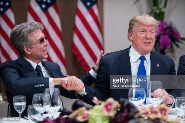 US President Donald Trump shakes hands with SAP CEO Bill McDermott during a working dinner with European business leaders during the World Economic...