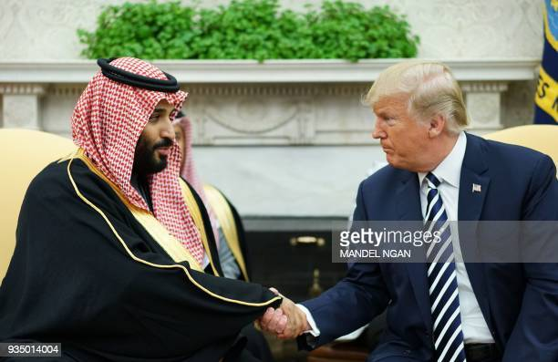 US President Donald Trump shakes hands with Saudi Arabia's Crown Prince Mohammed bin Salman in the Oval Office of the White House on March 20 2018 in...