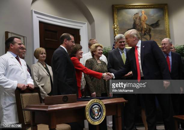 "S President Donald Trump shakes hands with Sen Susan Collins during a signing ceremony for the 'Know the Lowest Price"" Act and the ""Patient's Right..."