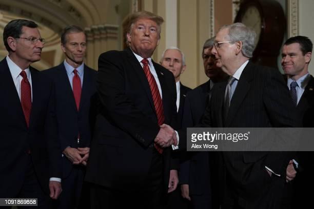 President Donald Trump shakes hands with Senate Majority Leader Sen. Mitch McConnell as Sen. John Barrasso , Sen. John Thune , Vice President Mike...
