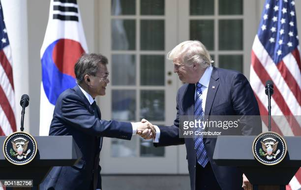 US President Donald Trump shakes hands with South Korean President Moon Jaein during a joint press conference in the Rose Garden at the White House...