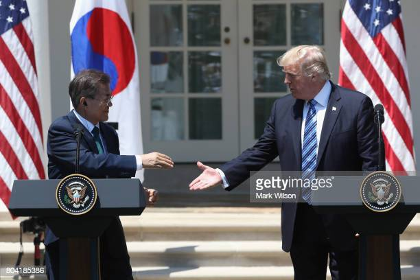 S President Donald Trump shakes hands with South Korean President Moon Jaein while delivering joint statements in the Rose Garden of the White House...