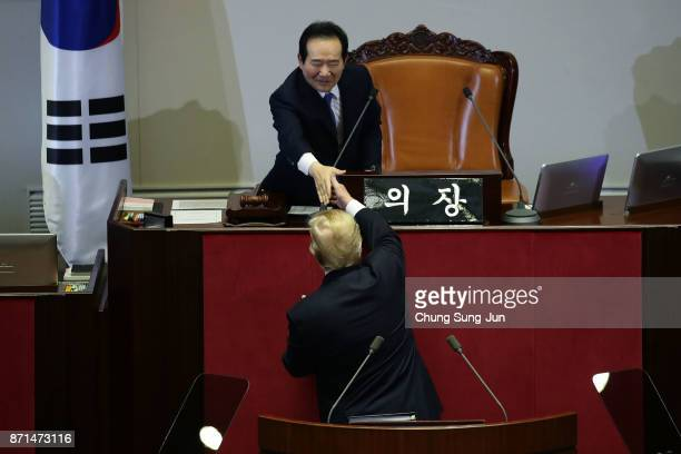 S President Donald Trump shakes hands with speaker of South Korean national assembly Chung SyeKyun after speech at the National Assembly on November...