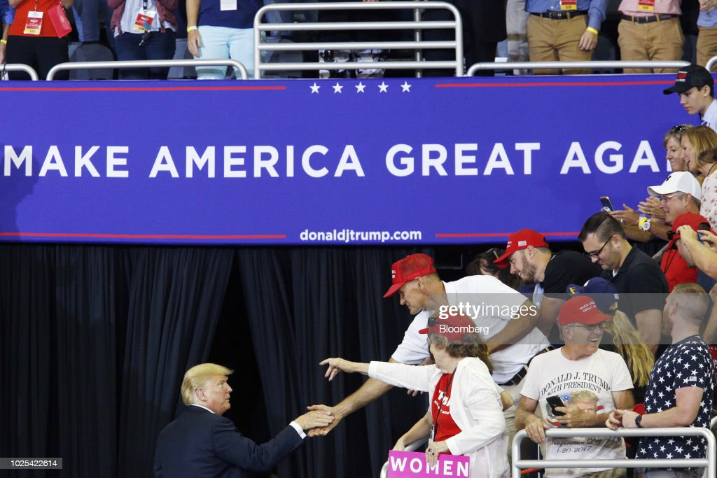 U.S. President Donald Trump shakes hands with supporters as he leaves a rally in Evansville, Indiana, U.S., on Thursday, Aug. 30, 2018. Trump wants to move ahead with a plan to impose tariffs on $200 billion in Chinese imports as soon as a public-comment period concludes next week, according to six people familiar with the matter. Photographer: Luke Sharrett/Bloomberg via Getty Images