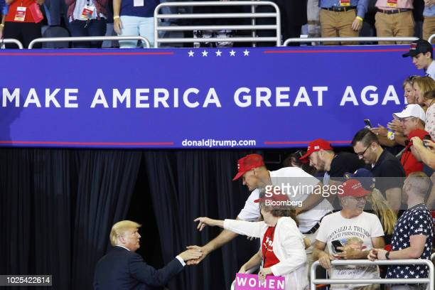US President Donald Trump shakes hands with supporters as he leaves a rally in Evansville Indiana US on Thursday Aug 30 2018 Trump wants to move...