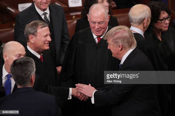 President Donald Trump shakes hands with Supreme Court Chief Justice John Roberts during a joint session of the U.S. Congress on February 28, 2017 in...