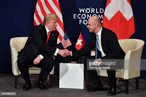 US President Donald Trump shakes hands with Swiss President Alain Berset during a bilateral meeting on the sideline of the annual meeting of the...