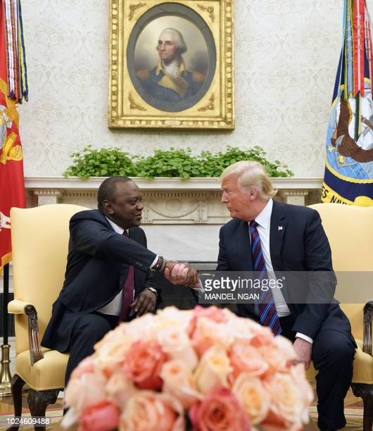 US President Donald Trump shakes hands with the president of Kenya President Uhuru Kenyatta at the White House on August 27 2018 in WashingtonDC