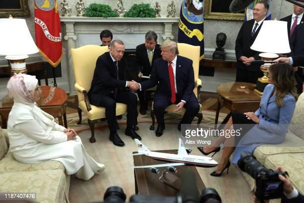 S President Donald Trump shakes hands with Turkish President Recep Tayyip Erdogan as US first lady Melania Trump and Turkish first lady Emine Erdogan...