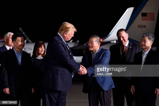 US President Donald Trump shakes hands with US detainee Kim Dongchul upon his return with fellow detainees Kim Haksong and Tony Kim after they were...