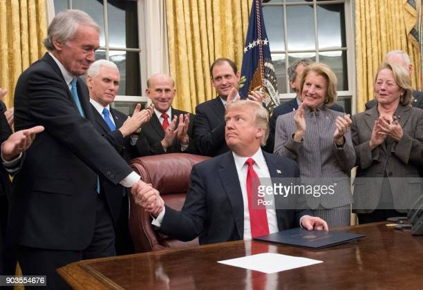 S President Donald Trump shakes hands with US Senator Ed Markey a sponsor of the bill after signing the bipartisan Interdict Act a bill to stop the...