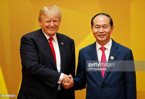 US President Donald Trump shakes hands with Vietnam's President Tran Dai Quang upon arrival for the APEC Economic Leaders' Meeting part of the...