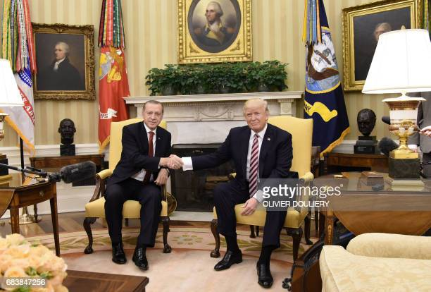 US President Donald Trump shakes hands with with President Recep Tayyip Erdogan of Turkey in the Oval Office of the White House in Washington DC on...