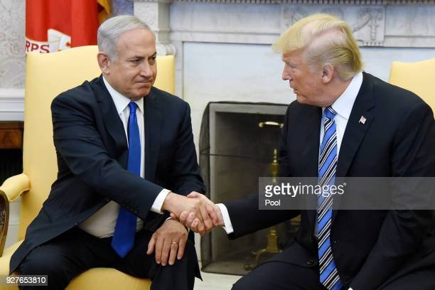 US President Donald Trump shakes hands withIsrael Prime Minister Benjamin Netanyahu as they meet in the Oval Office of the White House March 5 2018...