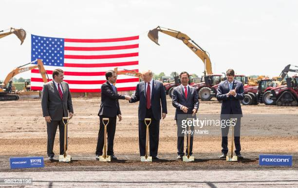 S President Donald Trump shakes hanks with Wisconsin Gov Scott Walker at the groundbreaking of the Foxconn Technology Group computer screen plant on...