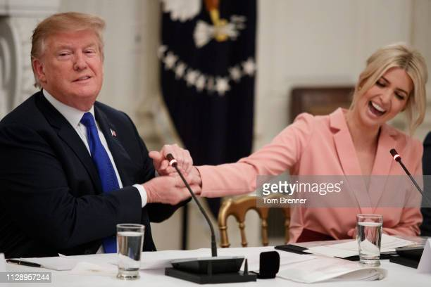 President Donald Trump shakes the had of his daughter and advisor Ivanka Trump during a meeting with the American Workforce Policy Advisory Board...
