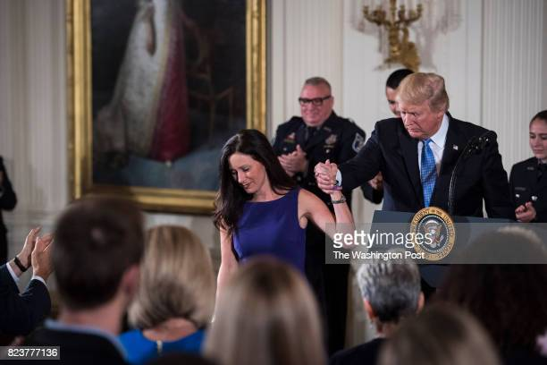 President Donald Trump shakes the hand of House Majority Whip Rep Steve Scalise's wife Jennifer Scalise as he recognizes the first responders from...