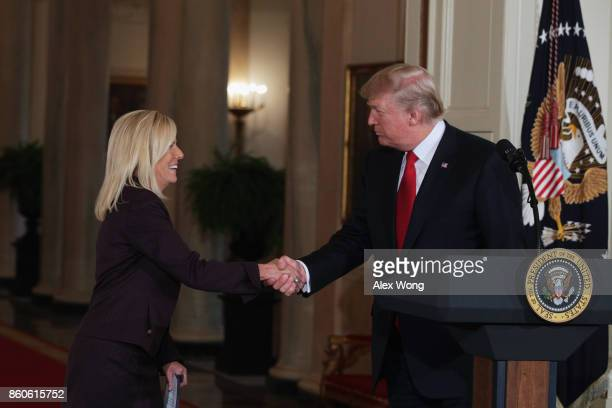 President Donald Trump shakes the hand of White House Deputy Chief of Staff Kirstjen Nielsen during a nomination announcement at the East Room of the...
