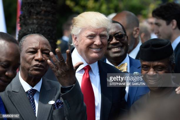 President Donald Trump shares a laugh with Guinea's President Alpha Conde , the Vice President of Nigeria Yemi Osinbajo and other African leaders as...