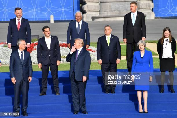 US President Donald Trump shares a light moment as he waits with other leaders before a group photograph ahead of a working dinner at The Parc du...
