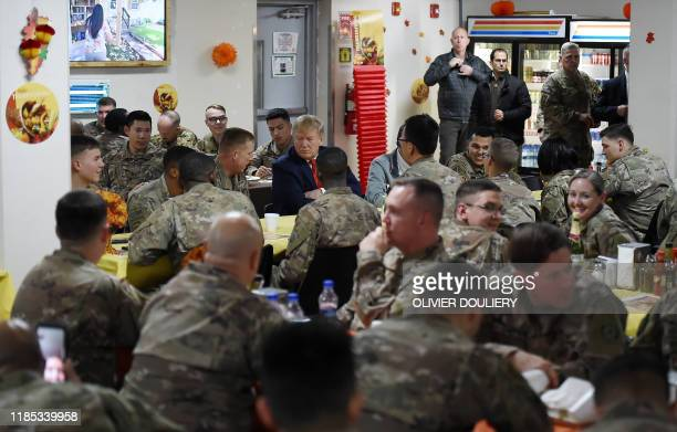 US President Donald Trump shares a Thanksgiving dinner with US troops at Bagram Air Field during a surprise visit on November 28 2019 in Afghanistan